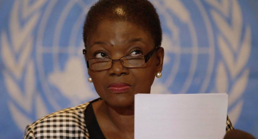 U.N. humanitarian chief Valerie Amos listens to a question after reading her statement at a news conference