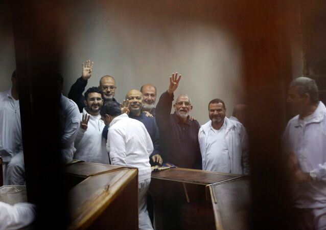 Muslim Brotherhood's Supreme Guide Mohamed Badie (3rd R) with other brotherhood members at a court in the outskirts of Cairo