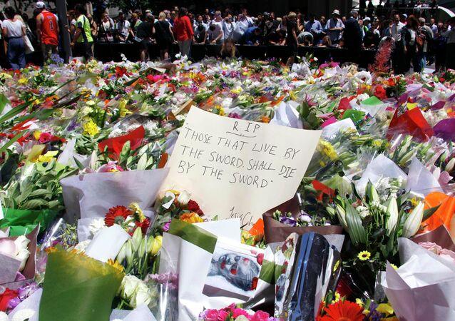 People bear flowers in memory of the dead in cafe in Sydney, Australia