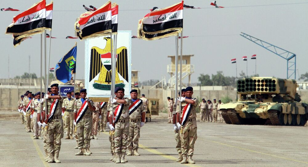 Iraqi Army soldiers march as part of a parade marking the founding anniversary of the army's artillery section in Baghdad.