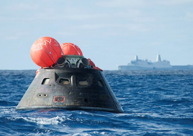 NASA shows NASA's Orion spacecraft after splash down as it awaits the U.S. Navy's USS Anchorage in the Pacific ocean