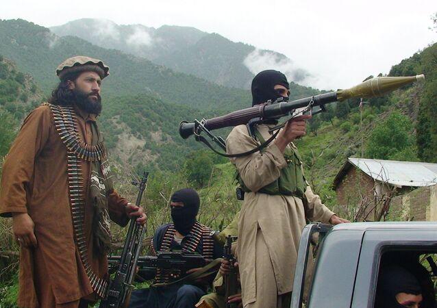 Pakistani Taliban patrol in their stronghold of Shawal in Pakistani tribal region of South Waziristan