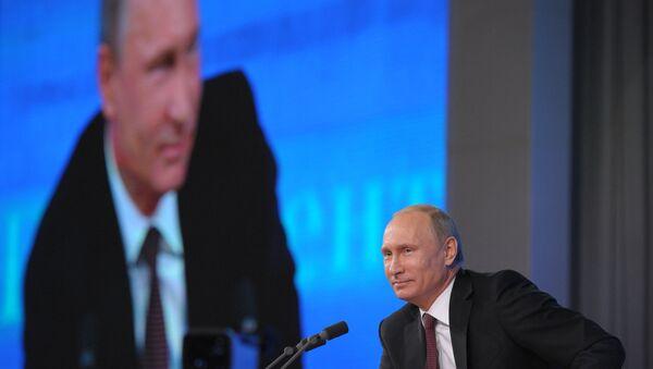 Russian President Vladimir Putin at major press coference on December 19, 2013. - Sputnik International
