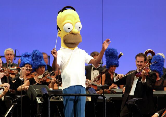 The orchestra, led by conductor Thomas Wilkins in a Homer Simpson costume, performs at the world premiere of The Simpsons Take the Bowl at the legendary concert venue in Los Angeles