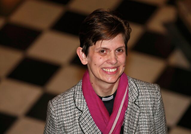 Libby Lane, a suffragan (Assistant) bishop in the Diocese of Chester, poses for photographers after her forthcoming appointment as the new Bishop of Stockport was announced in the Town Hall in Stockport, northern England