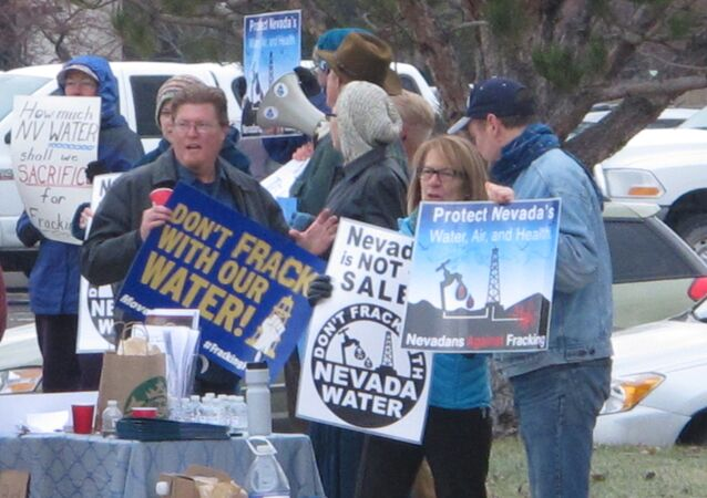 About two dozen anti-fracking protesters rally outside the U.S. Bureau of Land Management (BLM) in Reno