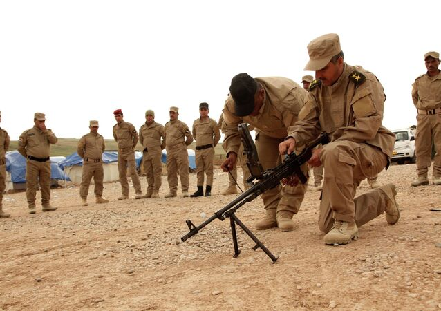 Sunni volunteers from Mosul take part in military training as they prepare to fight against militants of the Islamic State on the outskirts of Dohuk province December 8, 2014. Picture taken December 8, 2014.