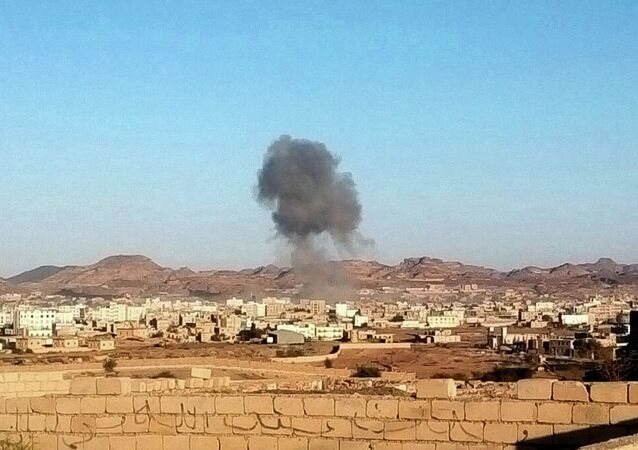 Smoke rises from the site of a car bomb explosion in Radda town,100 miles (160 kilometers) south of the capital Sanaa, Yemen, Tuesday, Dec. 16, 2014.