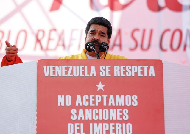 Venezuela's President Nicolas Maduro speaks during a rally to reject the sanctions that the U.S. government seeks to impose on officials accused of human rights violations, in Caracas December 15, 2014.