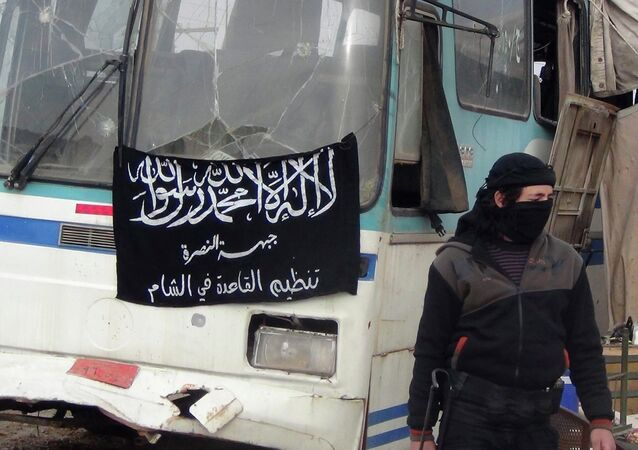 A member of Islamist Syrian rebel group Jabhat al-Nusra mans a checkpoint on the border crossing between Syria and Jordan, which they claim to have taken control of, in Daraa December 26, 2013.