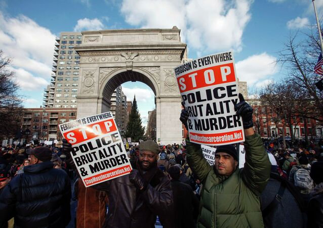 People take part in a march against police violence, in New York December 13, 2014.