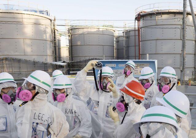 Members of a South Korean investigation team inspect the Fukushima Daiichi nuclear power plant in Okuma, Fukushima Prefecture, on Dec. 17, 2014