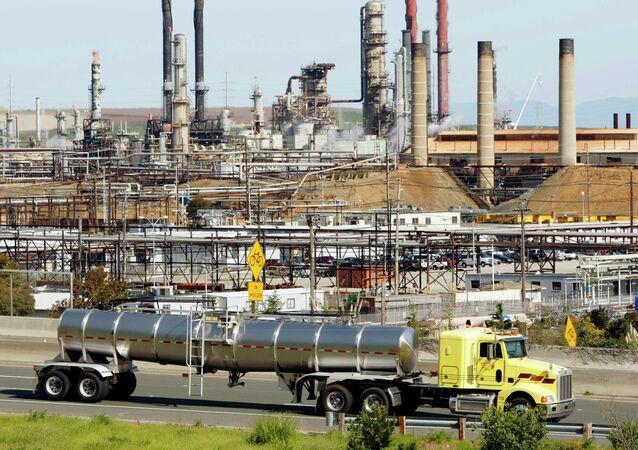 A tanker truck passing the Chevron oil refinery in Richmond, Calif.