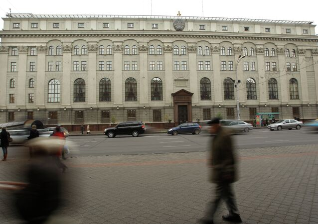 People pass by National Bank of the Republic of Belarus head building in the capital Minsk