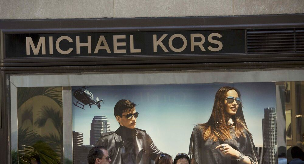 Signage for Michael Kors is seen at its Fifth Avenue store