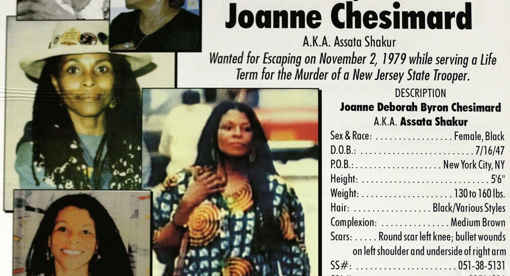 A poster with photographs of Joanne Chesimard