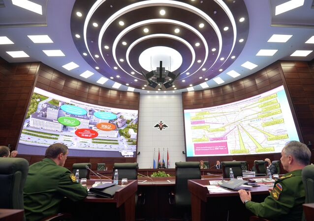 President Putin (center) chairing an expanded format meeting of the Defense Ministry's Board at the new National Defense Control Center.