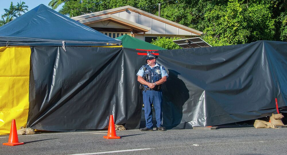 A policeman guards the scene of a stabbing attack at a home in Cairns, northern Queensland