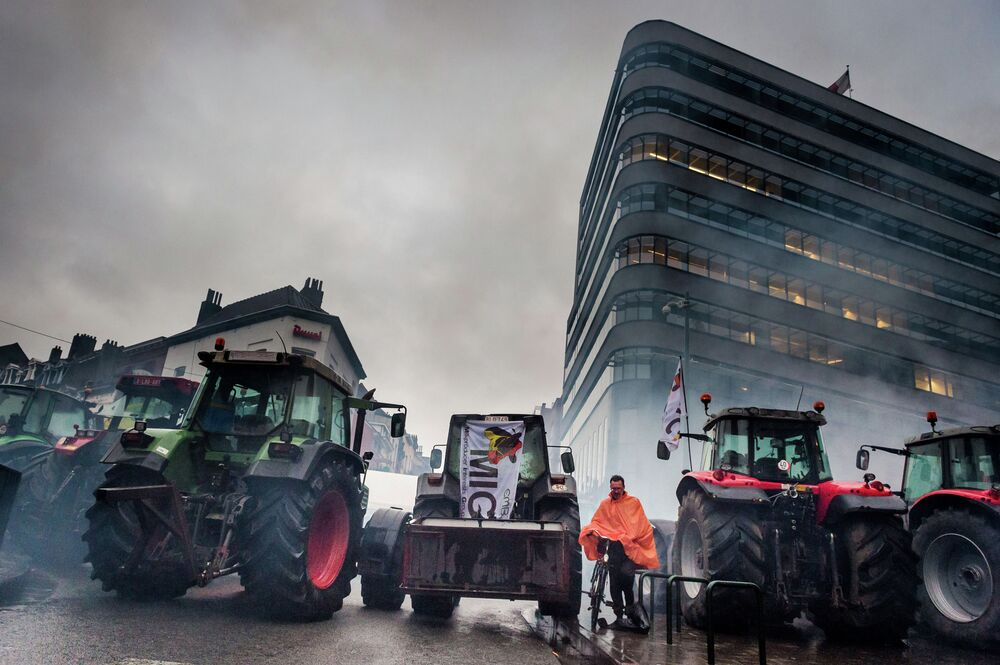 Tractors block a street in front of the European Commission headquarters