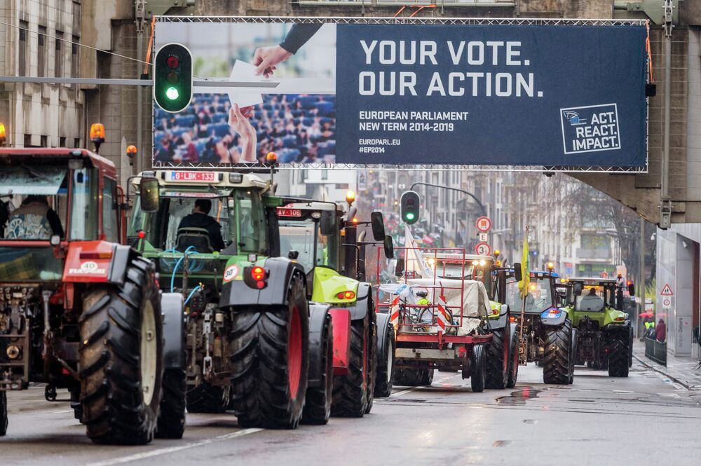 Farmers protest near the European Parliament in Brussels