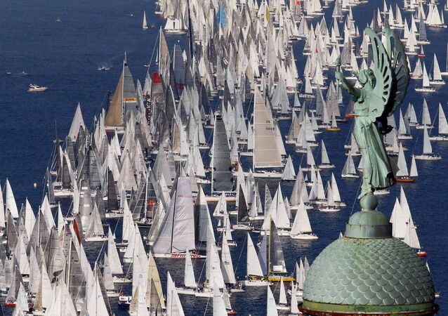 Sailing boats gather at the start of the Barcolana regatta in front of Trieste harbour October 12, 2014.