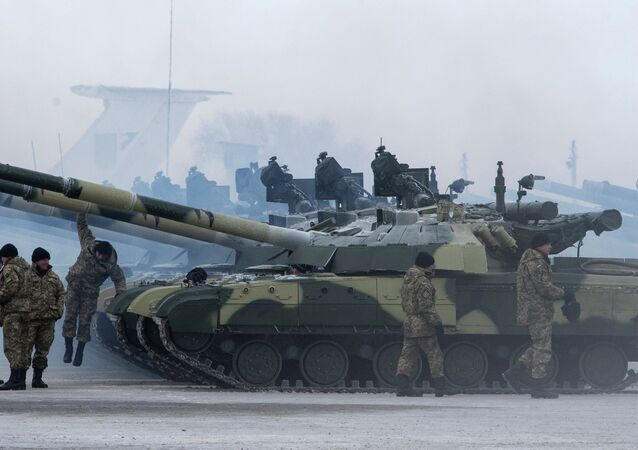 Ukrainian soldiers get new tanks and other military vehicles at a military base in the eastern town of Chuguyev, Ukraine, Saturday, Dec. 6, 2014