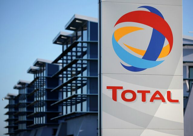 View of the logo of French oil giant Total in front of the oil refinery of Donges, near Nantes, in this December 20, 2013 file photo