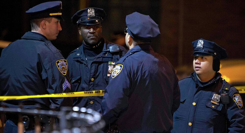 Police are pictured at the scene of a shooting where two New York Police officers were shot dead in the Brooklyn borough of New York, December 20, 2014