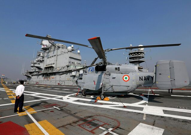 A Kamov 31 helicopter is parked on the deck of INS Vikramaditya, Indian Navy's aircraft carrier, is seen anchored in the Arabian sea off the coast of Mumbai December 3, 2014