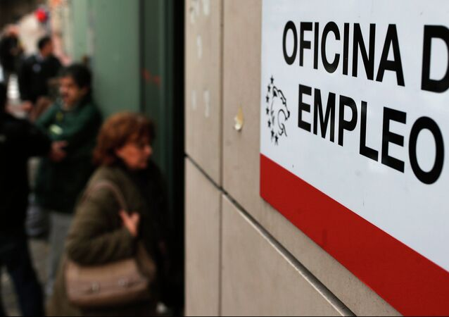 People enter an unemployment registry office in Madrid, Spain, Friday, Jan. 3, 2014