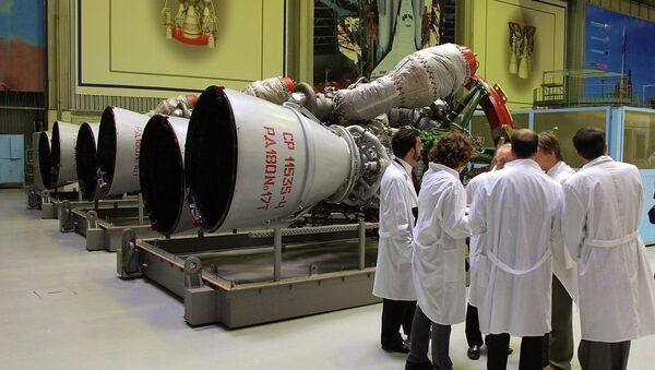Energomash company employees stand near RD-180 engines prepared for shipment to the United States in a shop at the Energomash - Sputnik International