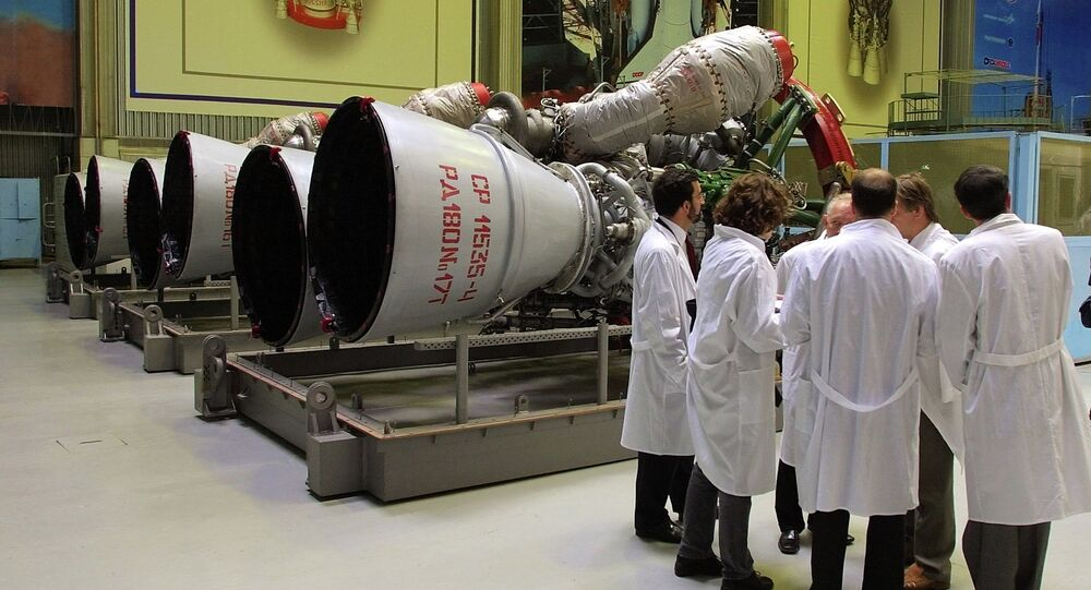 Energomash company employees stand near RD-180 engines prepared for shipment to the United States in a shop at the Energomash
