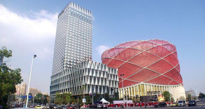 View of the Han Show Theater, right, and the Wanda Reign hotel in Wuhan city, central China's Hubei province, 20 September 2014
