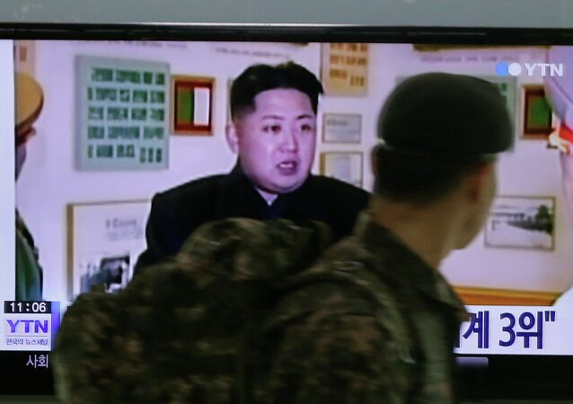 A South Korean army soldier watches a TV news program showing North Korean leader Kim Jong Un at the Seoul Railway Station in Seoul, South Korea, Monday, Dec. 22, 2014