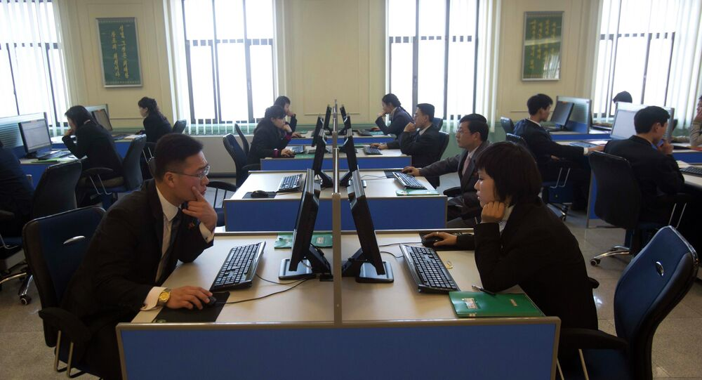 North Korean students work at computer terminals inside a computer lab at Kim Il Sung University
