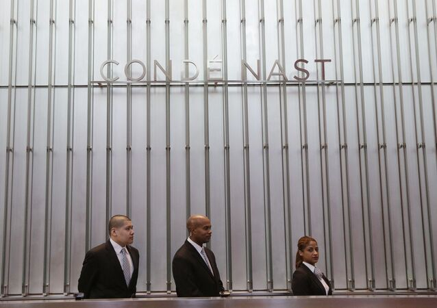 Employees are stated at the front desk for Conde Nast in the lobby of One World Trade Center Monday, Nov. 3, 2014 in New York