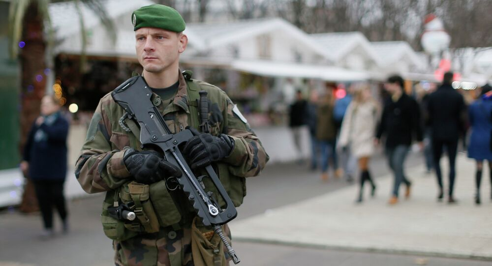 A French soldier patrols the Christmas market along Champs Elysees in Paris as part of the Vigipirate security plan December 23, 2014