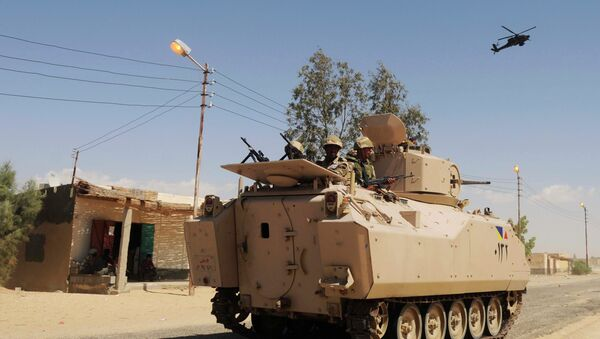 In this Tuesday, May 12, 2013 file photo, Egyptian Army soldiers patrol in an armored vehicle backed by a helicopter gunship during a sweep through villages in in Sheikh Zuweyid, northern Sinai, Egypt - Sputnik International