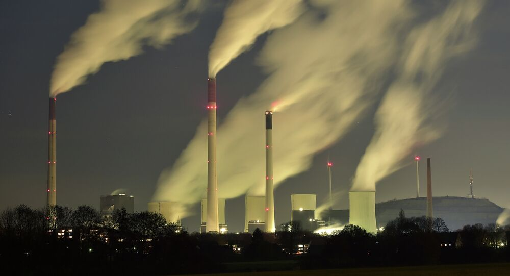 In this Monday, Nov. 24, 2014 file photo, smoke streams from the chimneys of the E.ON coal-fired power station in Gelsenkirchen, Germany