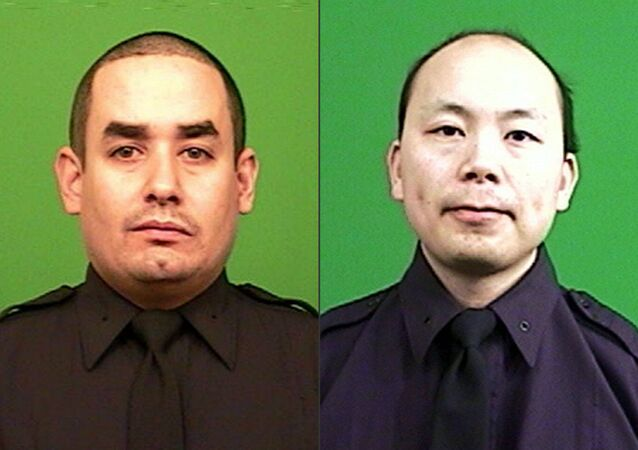 This combination made from photos provided by the New York Police Department shows officers Rafael Ramos, left, and Wenjian Liu