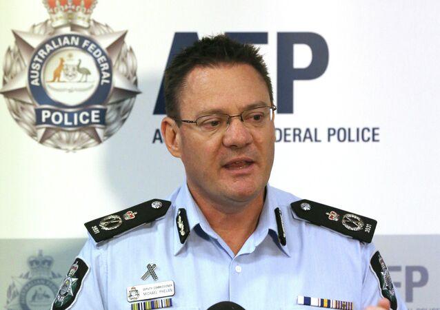 Australian Federal Police Deputy Commissioner Michael Phelan speaks to the media
