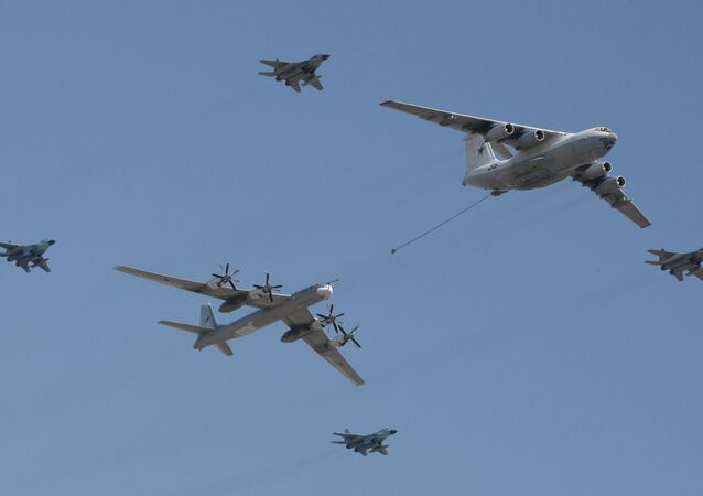 An Il-78 tanker aircraft, right, and a Tu-95 heavy bomber