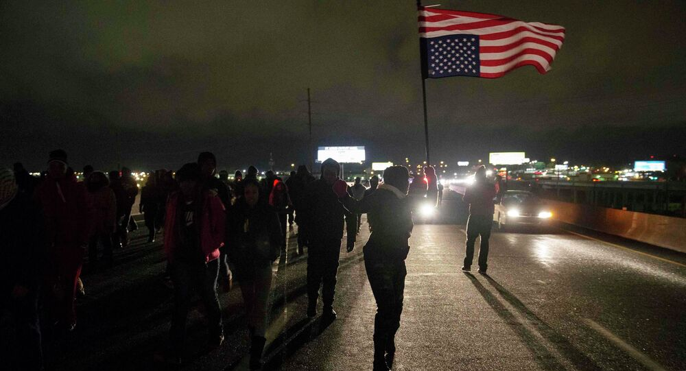 Protesters block Highway 170, after a man was fatally shot by a police man in Berkeley, Missouri, December 24, 2014.