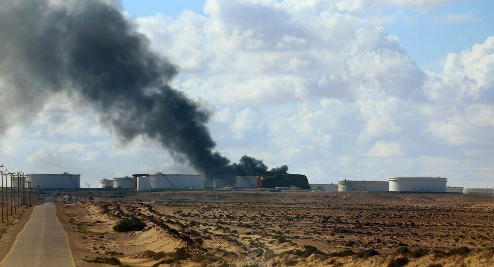 Black smoke billows out of a storage oil tank