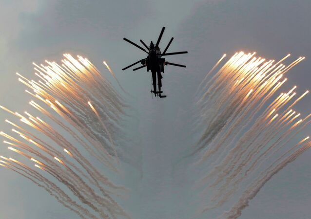 A couple of Russian Army helicopters fly over the Monument to Scuttled Ships, during a promotional campaign for contract service for Russian Army in Sevastopol