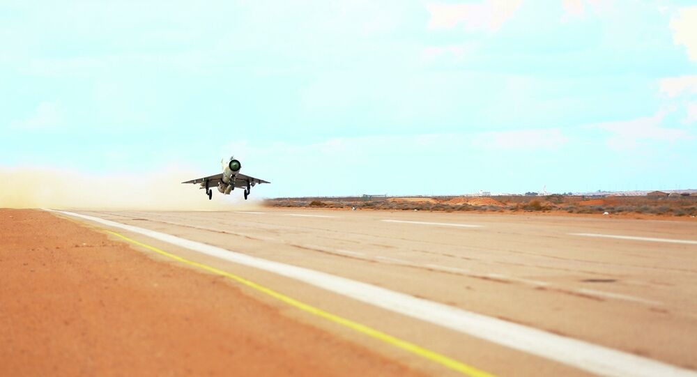 A MiG-21 fighter jet belonging to forces loyal to former general Khalifa Haftar takes off from a base on the outskirts of Al Sidra oil port, in Ras Lanuf