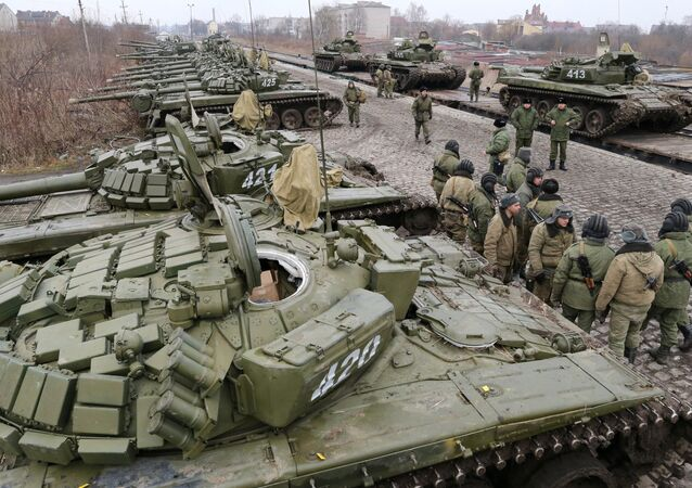 Soldiers of the separate tank battalion of the Baltic Fleet motorized infantry brigade, during loading of tanks on flatcars, for dislocation to the district selected for military exercises, in the city of Gusev, Kaliningrad Region.