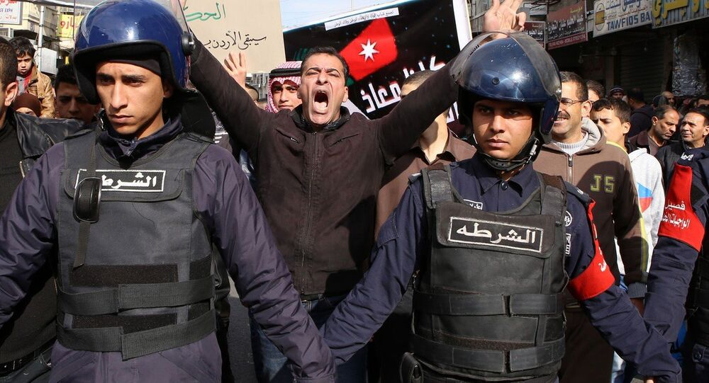 People shout slogans to call for the freedom of Jordanian pilot