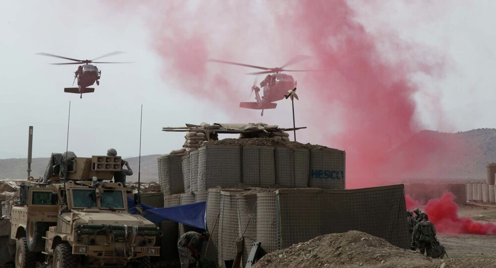 Black Hawk Helicopters coming in to land at firebase in Afghanistan