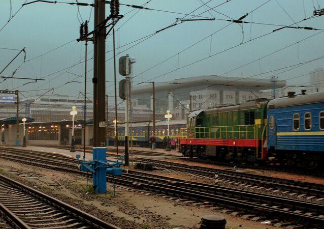 Ukraine railways diesel hauled train approaching Kiev central station